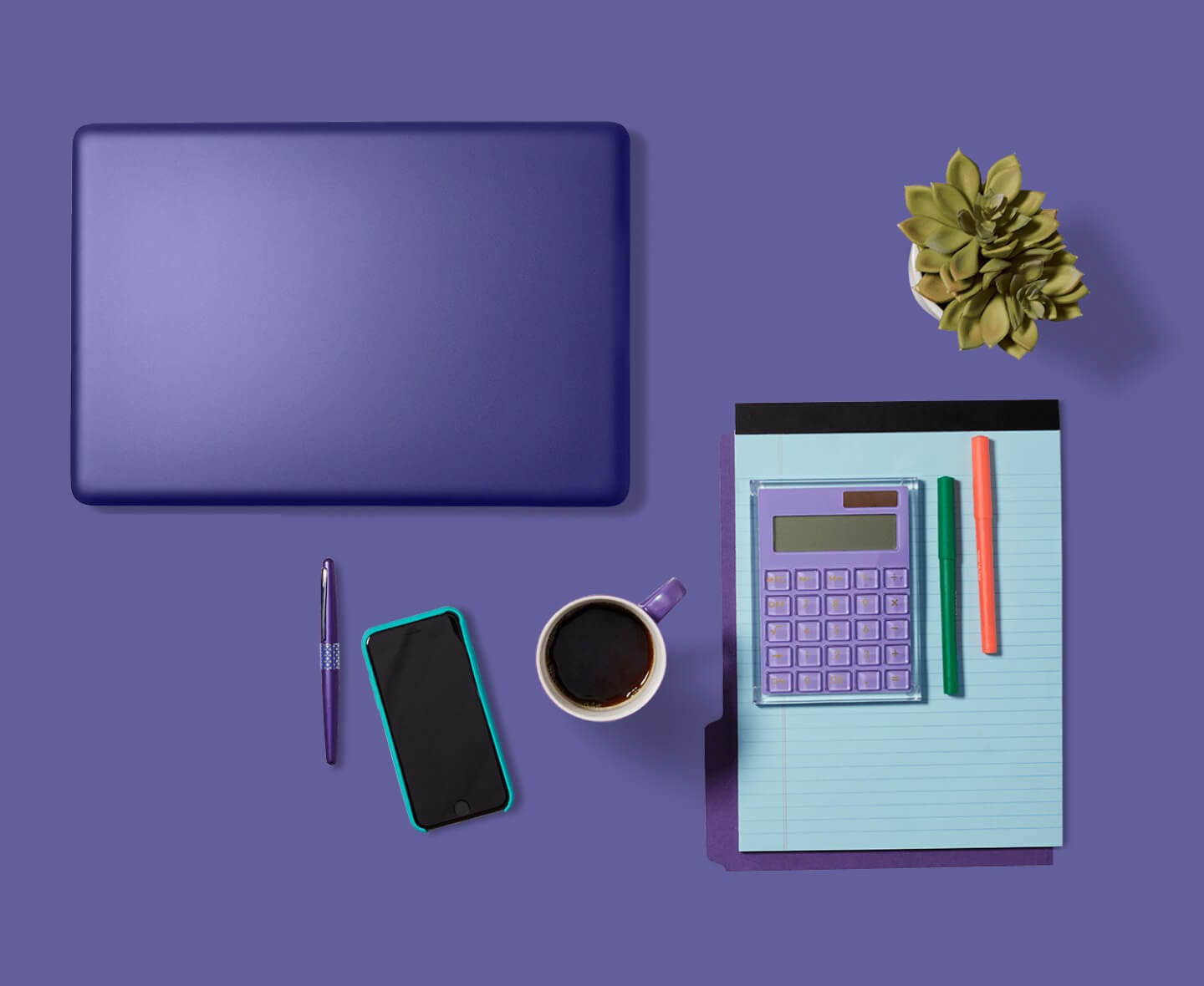 Panoramic view of laptop and office supplies